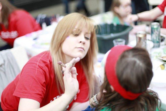 An image of a child getting their face painted at Gyle Family Fun Day as part of Care PR story