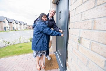 Robert and Jennifer unlock the door to their new home