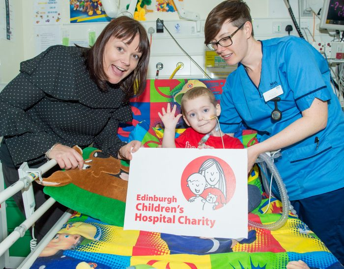 Edinburgh Children's Hospital Charity promotion photo featuring young boy, nurse and Roslyn the CEO for Edinburgh PR article