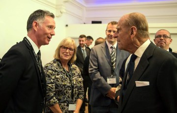 Public relations agency owner meets the Duke of Edinburgh