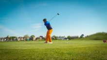Profile of golfer teeing off by Scottish PR Agency