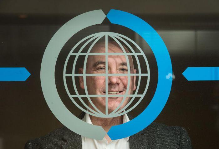 Ricky Nicol Commsworld looking through glass window and logo   Tech PR in Scotland