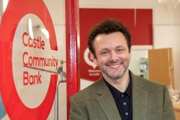 Pr photos of movie star Michael Sheen, who opened a new branch of a community bank in Edinburgh.