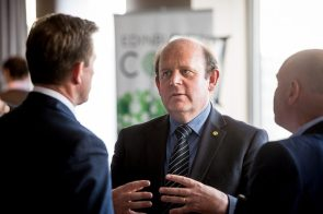 A tech PR photo of Councillor Frank Ross in conversation at CityFibre and Commsworld launch event