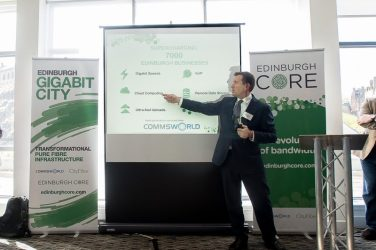 CityFibre CEO Greg Mesh in a tech PR photo of his presentation at CityFibre and Commsworld launch