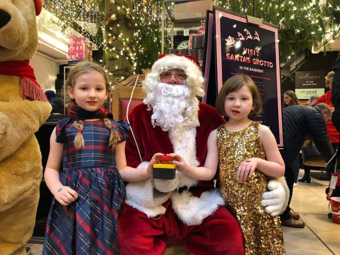 Charity PR photograph of Poppy Rennie and Bella Rennie switching on the Jenners Christmas lights 2018