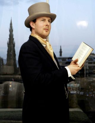 An actor playing Sir Walter Scott at the grand opening launch party of Fraser Suites, captured in hotel PR photography