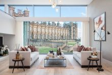 Property PR photograph featuring the living room at CALA Homes The Crescent - a sweeping curve of glass fronted contemporary apartments.