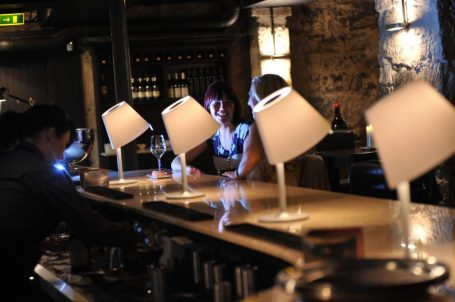 Guests are seen enjoying a drink at Edinburgh's Divino Enoteca in a Bar and Restaurant PR image