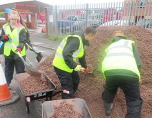 Pupils form Calderhead High School are captured in a Charity PR image whilst working to reopen a path in Shotts with help from Paths for All