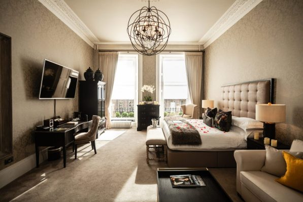 Nira Caledonia's sophisticated, romantic bedroom portrayed in a hotel PR photo campaign