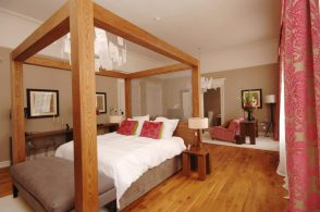 Four poster hotel suite bed and glamorous interior design at Tigerlily Edinburgh - hotel PR phtography