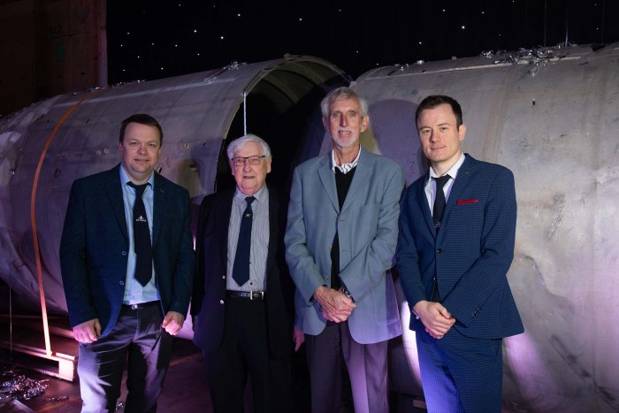 an image by Blue Sky Photography of Skyrora CEO Vladymir Levykin and Director Daniel Smith with engineers from the orginal Black Arrow launch