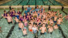 Scottish PR photograph of triple Olympian Hannah Miley and a group of kids in a swimming pool