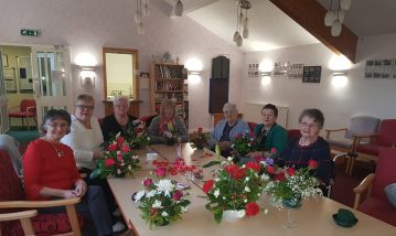 PR photograph image of Bield Southfield court tenants participating in a Valentine's day themed craft session