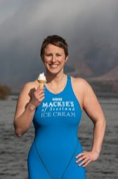 Jade Perry is captured by food and drink PR photography at Loch Lomond at Luss, Scotland in the water eating an ice cream cone