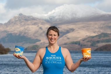 Jade Perry is pictured at Loch Lomond at Luss, Scotland balancing tubs of Mackie's ice cream captured by Food and Drink PR photography