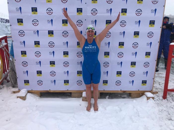 Jade Perry, Britain's record-breaking swimmer, celebrates a gold win in Russia