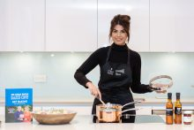 Bake off finalist Ruby Bhogal shows guests how to make her signature lemon mernigue pie at CALA home's, The Crescent at an influencer marketing event