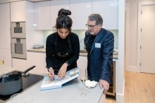 Ruby signs a copy of The Great British Bake Off book for a guest at CALA's latest development, The Crescent
