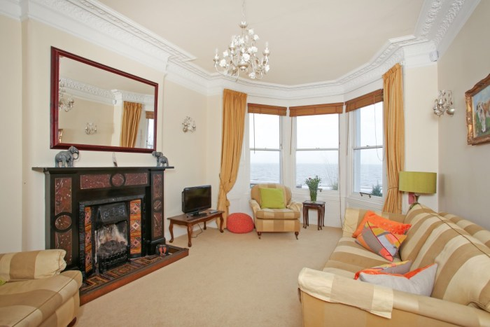 the gorgeous living room of luxury seaside villa by warners brought to your attention by holyrood pr