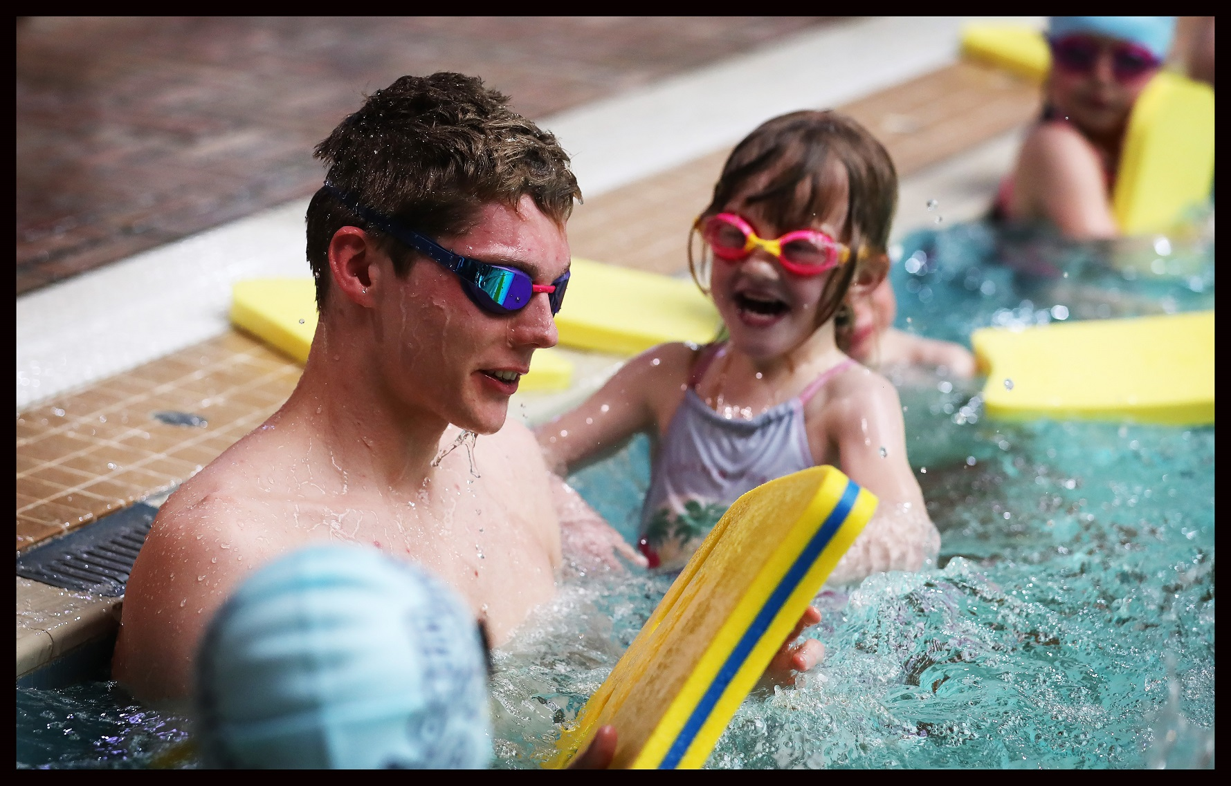 Public Sector PR photo of Learn to Swim Ambassador Duncan Scott in the pool with kids at Teviotdale Leisure Centre