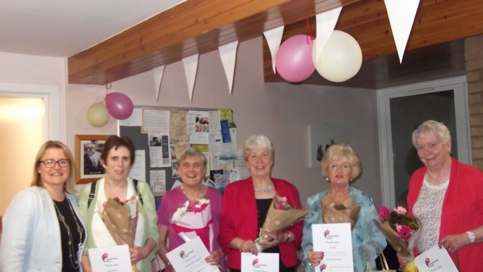 Charity PR image of volunteers at Bield's Mungo Park Court at a celebration held at the development as part of volunteers week