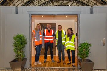 Care PR photo shows Blackwood team at Manchester Housing Conference where Blackwood House is being showcased in three shipping containers