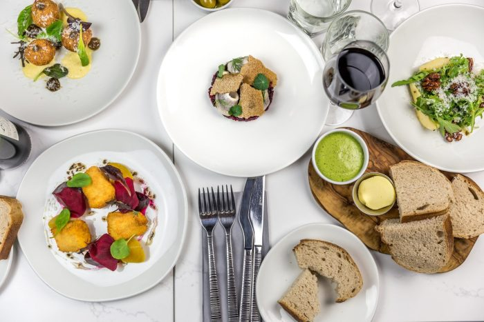 Food and drink PR photograph of a full table at Otro restaurant in Edinburgh