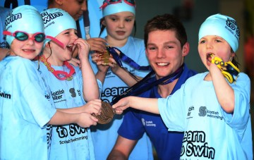 Scot swim star Duncan Scott with children on Learn to Swim programme - Public Sector PR
