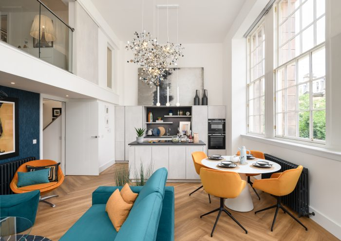 Shot showing the open plan kitchen and dining space the the Boroughmuir by CALA show apartment/showhome