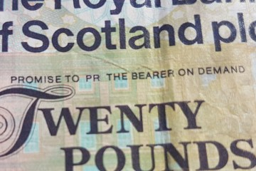 PR message on bank note to illustrate PR costs and charges