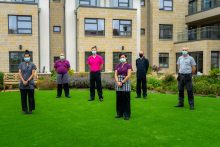 social care PR photography Cramond Residence staff socially distant with masks