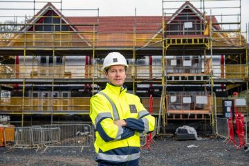 Craig Lynes in front of a house at CALA's Ravelrig Heights in Balerno