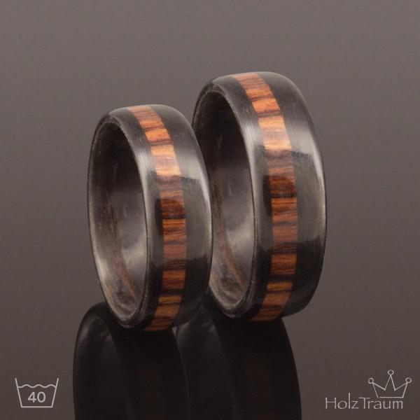 schwarze Holzringe mit Inlay aus Rosenholz Verlobungsringe, Eheringe, Trauringe aus Holz