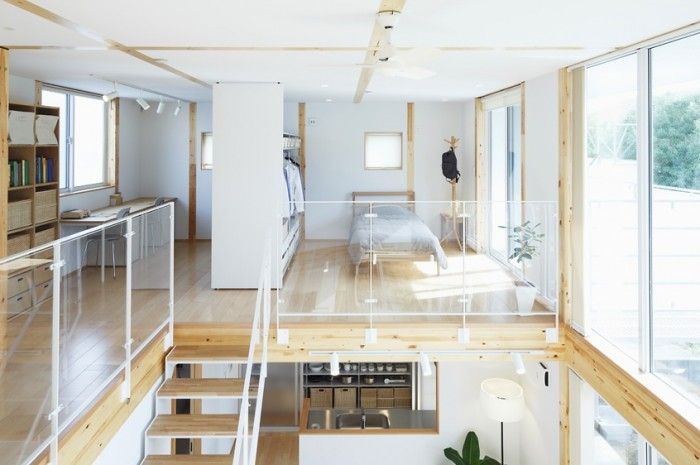 Wood insets in the ceiling and walls use line in its most simplistic form to create interest. Glass panels used as railing around the loft area allow light to travel through space.
