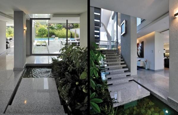 jardim aquático indoor no pé da escadaria de mármore flutuante