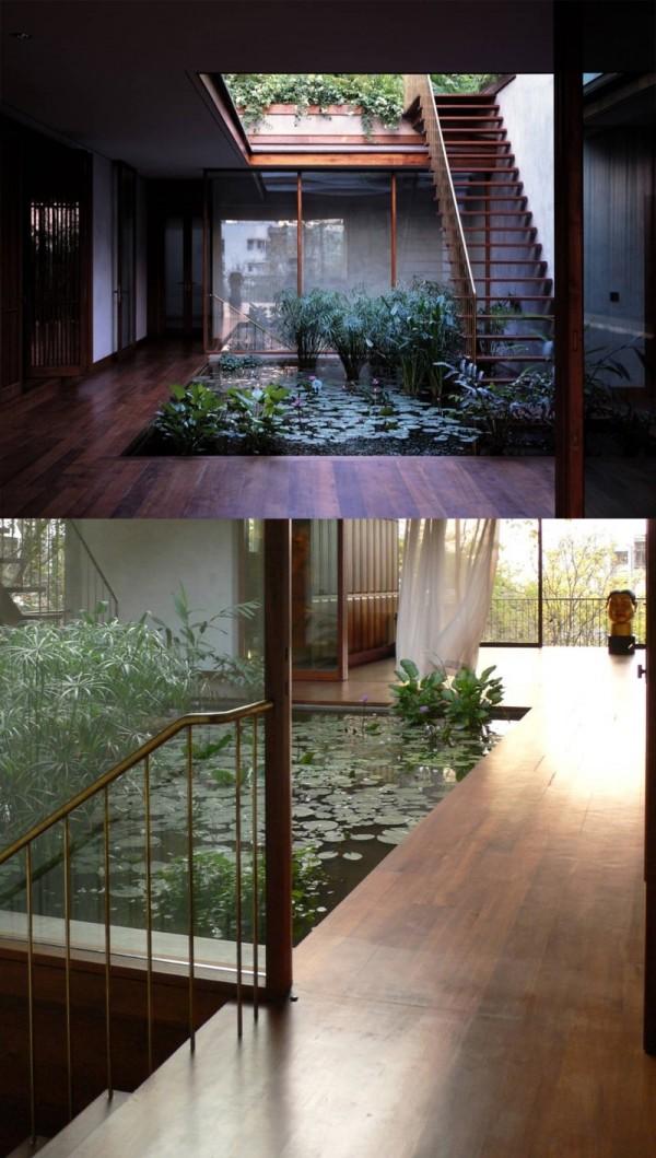 openair jardim interno de água cercada por madeira lisa