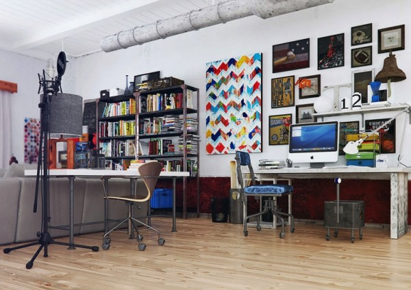 """Any modern apartment needs a useable workspace. This area, tucked away beside the sofa, gives a new meaning to the term """"corner office"""" while offering plenty of space for a creative to work away the hours."""