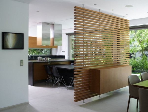Another easily installed piece, these wooden slats take inspiration from Japanese design and perfectly separate the dining area from the breakfast nook in this simply elegant home.