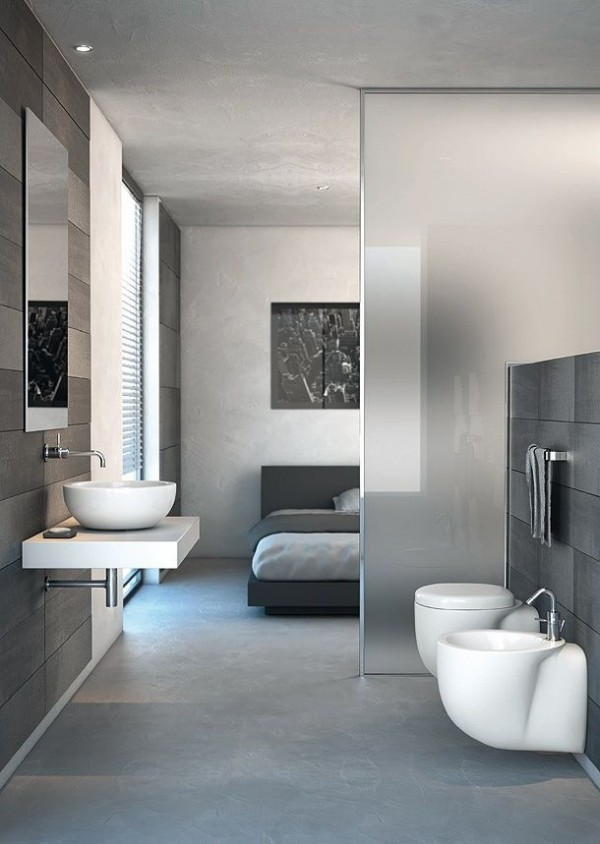 Taking the partition to the next level, this particular en suite does not even have a whole wall separating the bedroom from the bath, instead using frosted glass.