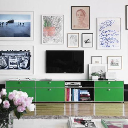 There was a time when surrounding a TV with artwork was considered taboo. Today, however, the TV can still have prime position, but without it being the most important feature in a room. In this type of setting the eye is drawn to surrounding artwork not not just the TV.