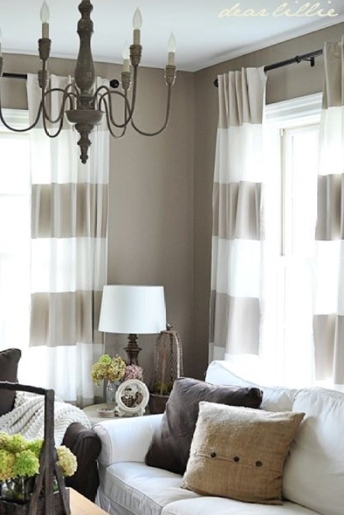 In a small room you don't have to paint walls to add horizontal stripes - use fabric. Curtains or rugs with horizontal stripes will also fool the eye into thinking a room a bigger.
