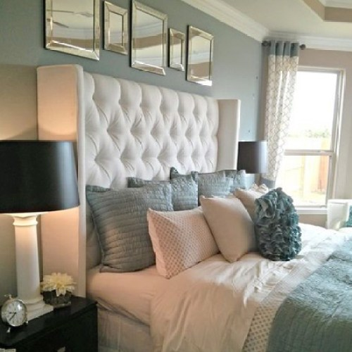 add upholstered headboard to insulate bedroom