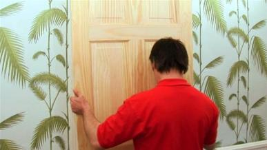 how to hang a door