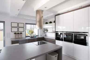 gray and white kitchen with sleek design and a glossy finish
