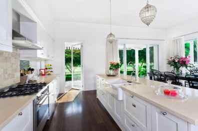 clean open plan white kitchen