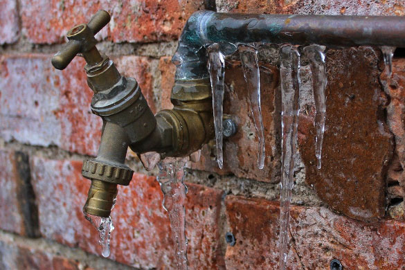 Exterior pipe without insulation is frozen