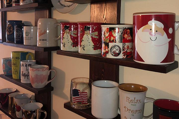 DIY wall mounted shelving unit to display a coffee mug collection