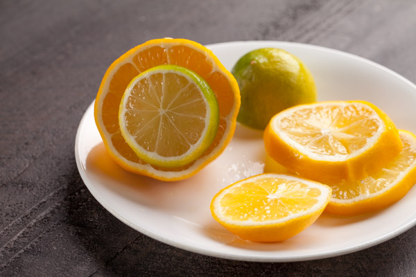 Making Lemonade - Meyer lemons and mexican lime sliced
